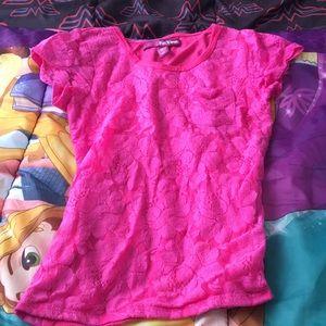 A floral designed pink shirt